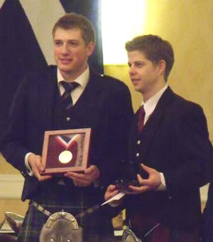Andrew Lee receiving the Gold Medal from R.G.Hardie's Alastair Dunn